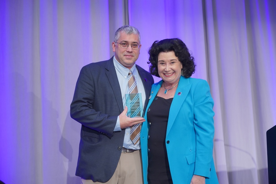 ASA Excellence in Government Award winner Joshua Chance, M.D., stands next to ASA President Linda Mason, M.D., FASA