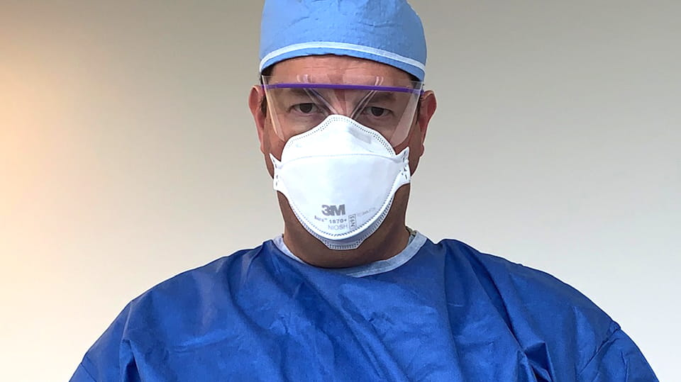 Dr. Ori Gottlieb in protective CAPR hospital wear